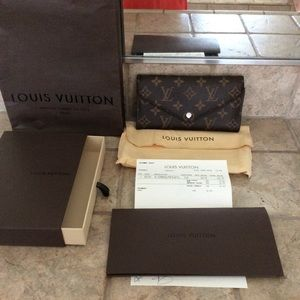 Louis Vuitton Josephine wallet. Gently used.